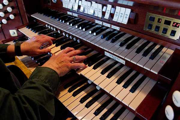 David Lamb, music director of Trinity United Methodist Church, plays the Horace Wesley Cutler Memorial Pipe Organ in the sanctuary of the church in New Albany. Staff photo by Christopher Fryer