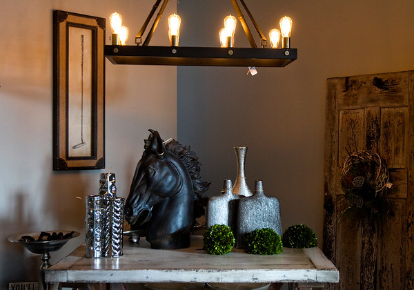 Various home accessories are pictured inside Madhouse, a home decor and gift boutique, which opened for business in downtown New Albany last October. Staff photo by Christopher Fryer