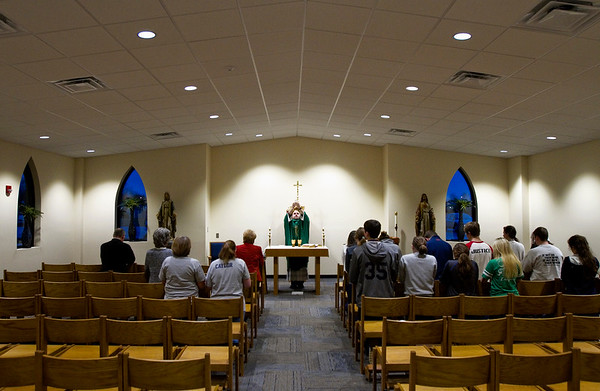 Rev. Adam Ahern, center, leads a morning mass before the school day begins at Our Lady of Providence Junior-Senior High School in Clarksville. Staff photo by Christopher Fryer