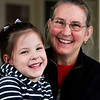 "Dr. Rita Ann Fleming is pictured with her granddaughter, Breslyn Dozal, 4, both of Jeffersonville, at her office in downtown Jeffersonville last week. Fleming recently authored ""Does Grandma Have a Mustache?"", which is a collection of humorous poems for grandparents to read to their grandchildren. Staff photo by Christopher Fryer"