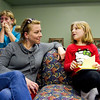 Volunteer Jessica Coons, left, talks with her cousin, Kynnedy Carta, 6, both of New Albany, during the weekly My Club meeting at St. John United Presbyterian Church in New Albany on Monday evening. My Club is a mentoring program run through Christian Formation Ministries that is designed to help the children of parents that have been or are currently incarcerated. Staff photo by Christopher Fryer