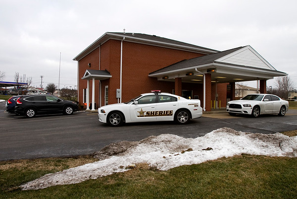 Law enforcement vehicles are pictured outside of First Harrison Bank, 4609 Williamsburg Station Rd., in Floyds Knobs after the bank was robbed at about 12 p.m. Wednesday. Staff photo by Christopher Fryer