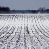 Snow drifts across a row-crop field near New Washington on Tuesday afternoon. According to the National Weather Service, the high on Wednesday will be near 29 with mostly sunny skies. Staff photo by Christopher Fryer