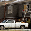 Smoke and fire damage is pictured on the front of building 802 of The Cambridge Apartments at the corner of Wellington Court and Cambridge Boulevard in Clarksville on Wednesday afternoon. The structure caught fire at about 8 a.m. Wednesday. Staff photo by Christopher Fryer