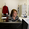 Deputy Clerk Cindy Comstock, Charlestown, works at her desk in the Clark County Clerk's Office at the Clark County Government Center in downtown Jeffersonville on Friday afternoon. The office is one of two in the state using a new electronic filing system for court related paperwork. Staff photo by Christopher Fryer
