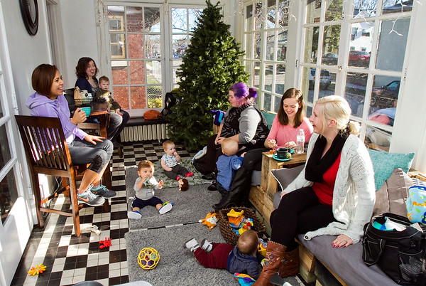 From left, Ariane Marsden, Memphis, Danielle Allen, New Albany, Abbie Higginbottom, New Albany, Mackenzie Thieneman, Scottsburg, and Robin Thompson, Clarksville, share a laugh during a postpartum support group meeting at Sparrow's Tree Modern Baby Boutique in New Albany on Tuesday. The business, owned by Allen and her husband, holds group meetings for mothers with various themes and focuses every Tuesday morning. Staff photo by Christopher Fryer