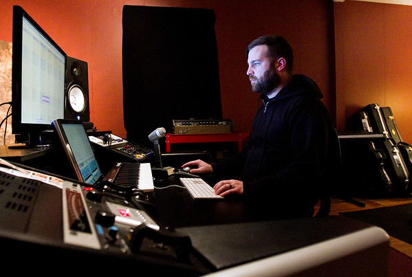 Producer and editor Michael Sanders, Jeffersonville, is pictured at his work station while demonstrating the editing process on a vocal track at Jetlag Recordings in Jeffersonville on Tuesday evening. Staff photo by Christopher Fryer