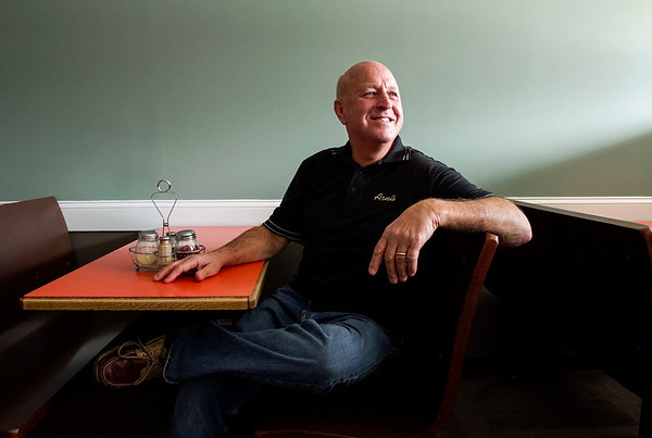 Bob Allen, 62 is pictured in the dining room at Arni's Restaurant in Floyds Knobs on Thursday afternoon. Allen started working for the pizzeria at 17 and worked there for more than 44 years. He retired month. Staff photo by Christopher Fryer