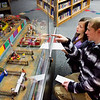 Yenawine descendants, Derek Criner, Clarksville, a great grandson, and his niece, Kessa Kemmer, 8, Jeffersonville, a great great granddaughter, search the Town Carnival Diorama of The Yenawine Dioramas during a scavenger hunt following an opening ceremony for the folk art exhibit at the New Albany-Floyd County Public Library in downtown New Albany on Thursday evening. Merle Yenawine created about 60 dioramas in the mid-twentieth century and 14 of them are on display in the exhibit, which moved to the library from the Carnegie Center for Art and History in November of last year. Staff photo by Christopher Fryer