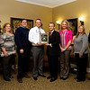 Elder Advisers presented Green Valley Care Center with the 2015 Diamond Award for Excellent Service earlier this month in New Albany. The Green Valley staff was recognized for its dedication, compassion and level of care provided to patients. From left, Business Office Manager Tonya Morgan, Assistant Business Office Manager Amy McHugh, State Representative Ed Clere, Executive Director Jesse Ray, Elder Advisers CEO Larry Weiss, Personal Assistant Denise Manecke, News and Tribune representative Christina Vincent, and McNeely Stephenson Elder law attorney Steven P. Langdon. Elder Advisers is based in New Albany  and specializes in financial planning and asset protection for seniors and families in Kentuckiana. Staff photo by Christopher Fryer