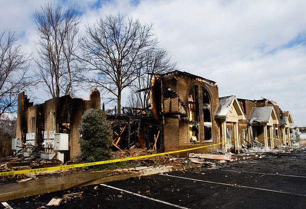 The fire-damaged remnants of the Charlestown Crossing Business Centre are pictured along the 3000 block of Charlestown Crossing in New Albany on Monday afternoon. Staff photo by Christopher Fryer