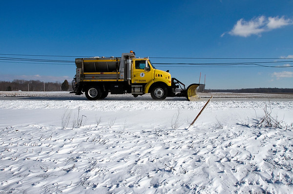 An Indiana Department of Transportation snow plow moves westbound along Ind. 62 near New Washington on Tuesday afternoon. According to the National Weather Service, temperatures will remain cold Wednesday with a high near 29. Staff photo by Christopher Fryer