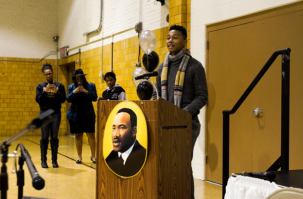 "Kentucky State University speech minor Michael Weaver, St. Louis, recites ""I Am KSU"" during the Dr. Martin Luther King, Jr. Community Celebration at the Griffin Recreation Center in New Albany on Monday evening. Weaver was one of four KSU speech minors that presented pieces at the event. Staff photo by Christopher Fryer"