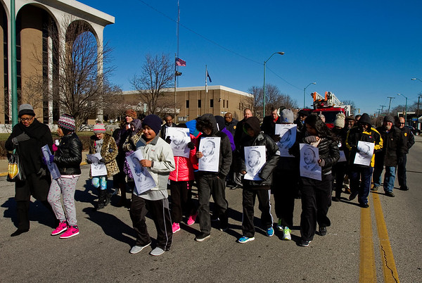 Marchers move along Court Avenue from the Clark County Government Building to First Presbyterian Church in observance of Martin Luther King Jr. Day in downtown Jeffersonville on Monday afternoon. Staff photo by Christopher Fryer