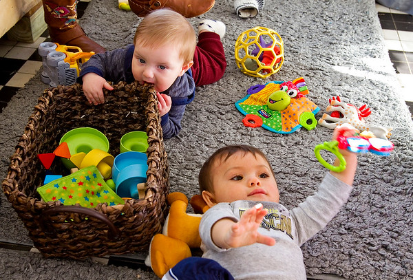 Roark Thompson, six months, Clarksville, left, and Elisha Marsden, eight months, Memphis, play on the floor while their mothers attend a postpartum support group meeting at Sparrow's Tree Modern Baby Boutique in New Albany on Tuesday. Staff photo by Christopher Fryer