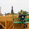 A construction crew works on Building A of The Breakwater apartment complex, 411 E. Spring St., in downtown New Albany on Thursday afternoon. Assistant Superintendent Chris Gehlhausen, with Flaherty & Collins Properties, said Building A of the project, which is one of the three main structures on the site, should be completed by the end of 2016. Staff photo by Christopher Fryer