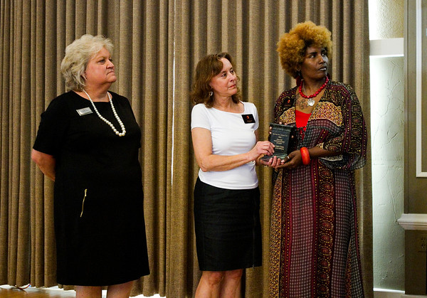 Sally Newkirk, center, and Delesha Thomas, right, accept the Foundation Award on behalf of the Carnegie Center for Art and History during the 2016 Develop New Albany PIllar Awards in the Bliss Ballroom at the Calumet Club in New Albany on Thursday evening. Staff photo by Christopher Fryer