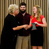 Kaitlin Hein, right, and Ansel Freibert, center, accept the Horizon Award on behalf of Seeds and Greens Natural Market and Deli during the 2016 Develop New Albany PIllar Awards in the Bliss Ballroom at the Calumet Club in New Albany on Thursday evening. Staff photo by Christopher Fryer