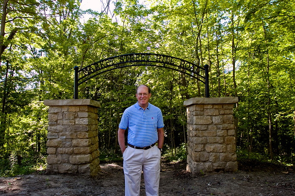 Silver Hills Historical Society Executive Director Kelly Carnighan is pictured at the entrance to The Silver Hills Historic Nature Trail at the foot of Silver Hills in New Albany that incorporates part of the city's former trolley car line. Staff photo by Christopher Fryer