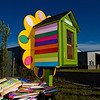 The new Little Free Library located at Silver Street Park is pictured prior to a ribbon cutting ceremony at the New Albany facility Thursday evening. The library was donated by Girl Scout Troop 114, who were involved in every step of the construction of the library from the initial design to the final paint job. Staff photo by Christopher Fryer
