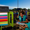 "Marissa Higgins, 10, with Girl Scout Troop 114, places books into the new Little Free Library that her troop donated as their year-end service project during a ribbon cutting ceremony at Silver Street Park in New Albany on Thursday evening. The 13 scouts in the troop were involved in every step of the construction of the library, from the initial design to the final paint job, with help from a friend of the troop for the advanced carpentry. ""We are very fortunate to have a great group of young leaders like Girl Scout Troop 114 engaging their community and promoting literacy,"" said New Albany Mayor Jeff Gahan, who was in attendance at the ceremony. Staff photo by Christopher Fryer"