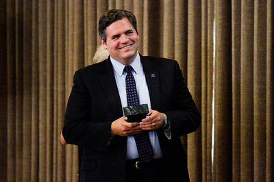 State Rep. Ed Clere accepts the Achievement Award during the 2016 Develop New Albany PIllar Awards in the Bliss Ballroom at the Calumet Club in New Albany on Thursday evening. Staff photo by Christopher Fryer