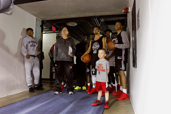 New Albany waits for McCutcheon to exit the court prior to the Bulldogs' practice session at Bankers Life Fieldhouse on Wednesday afternoon in Indianapolis. The two teams are scheduled to compete for the Class 4A state title at the arena Saturday night. Staff photo by Christopher Fryer