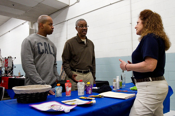 Production employees Robin Barnett, left, and Tony Williams, center, both of Jeffersonville, talk with Teresa Wiedemer, Charlestown, an HR assistant with American Fuji Seal, during a job fair Monday afternoon at the New Albany Pillsbury plant. General Mills announced last year that they will close the plant in 2016, and more than 40 employers were present at the job fair to assist employees with employment opportunities. Staff photo by Christopher Fryer