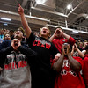 New Albany students cheer during a pep rally in The Doghouse on Friday morning ahead of the Bulldogs' departure for the Class 4A Richmond Semistate where they will face Southport on Saturday afternoon. Staff photo by Christopher Fryer