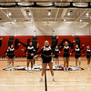 The New Albany Cheerleaders lead the student body through a cheer during a pep rally in the Doghouse on Tuesday ahead of the Bulldogs' Class 4A state championship game against McCutcheon that is scheduled for Saturday night at Bankers Life Fieldhouse in Indianapolis. Staff photo by Christopher Fryer