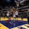 New Albany junior Isaac Hibbard drives to the basket during the Bulldogs' practice session Wednesday afternoon at Bankers Life Fieldhouse in preparation for the team's game against McCutcheon in the Class 4A state championship scheduled for Saturday night at the arena in downtown Indianapolis. Staff photo by Christopher Fryer