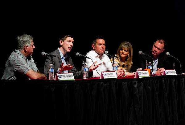 Panel meteoroligists, from left, Andy Weingarten, Ryan Hoke, Brian Goode, Christie Dutton, and Kevin Harned field questions during the Wave 3 News Weather Town Hall Meeting in partnership with the News and Tribune at Indiana University Southeast's Ogle Center in New Albany on Tuesday evening. Staff photo by Christopher Fryer
