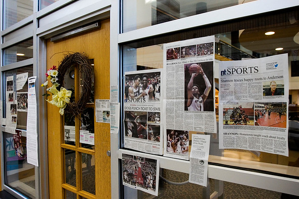 Newspaper articles that chronicle New Albany's road through the post-season are pictured at an entrance to the school's library Tuesday. The Bulldogs are scheduled to take on McCutcheon for the Class 4A state title at Bankers Life Fieldhouse in Indianapolis on Saturday night. Staff photo by Christopher Fryer