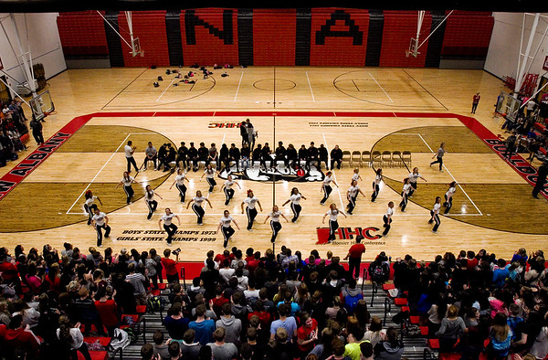 The New Albany cheerleaders lead students, faculty and staff in the school fight song during a pep rally in the Doghouse on Friday morning ahead of the Bulldogs' departure for the Class 4A Richmond Semistate where they will face Southport on Saturday afternoon. Staff photo by Christopher Fryer