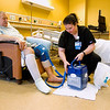 Orthopaedic/Spine Nurse Navigator Sarah Shemanski, Borden, adjusts a cooling unit for knee replacement patient Michael Backherms, Clarksville, in the Surgical Inpatient Unit at Floyd Memorial Hospital on Tuesday afternoon. Staff photo by Christopher Fryer