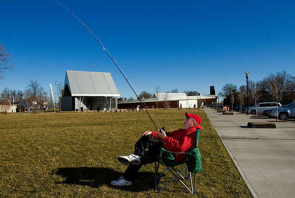Robert Eames, Jeffersonville, uses a fishing pole to pilot a fighter kite at Big Four Station in downtown Jeffersonville on Monday afternoon. Eames said that using the pole makes flying easier for him, and that he also enjoys the novelty of the technique. Eames owns about 75 kites and has been flying since his grandfather introduced him to the hobby 61 years ago. Staff photo by Christopher Fryer
