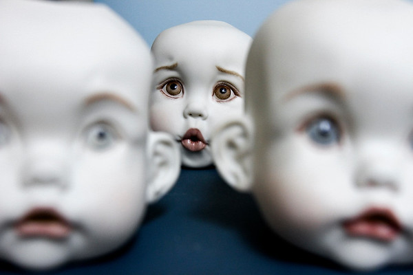 Doll heads are pictured on a table in the studio of doll artisan Debbie Adkins at her New Washington home. Staff photo by Christopher Fryer