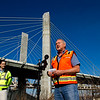 Steven Schauer, a project manager with Walsh Construction, speaks during a press conference held along the Louisville riverfront surrounding the current state of the downtown crossing portion of the Ohio river Bridges Project on Tuesday morning. Staff photo by Christopher Fryer