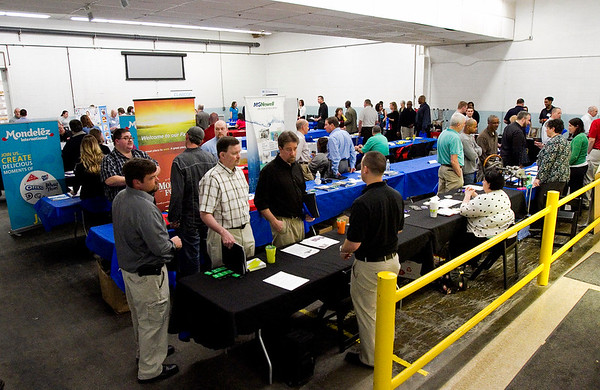 Pillsbury plant employees move between booths during a job fair at the General Mills facility in New Albany on Monday afternoon. Staff photo by Christopher Fryer