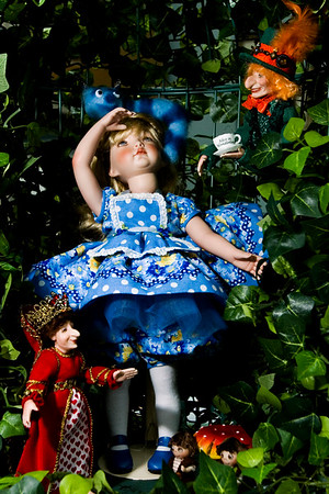 "An ""Alice's Adventures in Wonderland"" scene titled ""Down the Rabbit Hole"" is pictured in the studio of doll artisan Debbie Adkins in her New Washington home. Staff photo by Christopher Fryer"