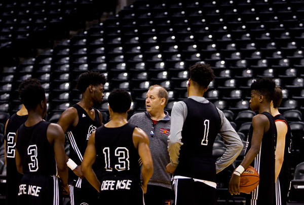 New Albany Head Coach Jim Shannon talks to his team during a practice session at Bankers Life Fieldhouse on Wednesday afternoon in Indianapolis. The Bulldogs' are scheduled to play McCutcheon for the Class 4A state title at the arena Saturday night. Staff photo by Christopher Fryer