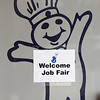 A job fair sign is pictured on a door at the New Albany Pillsbury plant Monday afternoon. General Mills announced last year that they will close the plant in 2016, and more than 40 employers were present at the job fair to assist employees with employment opportunities. Staff photo by Christopher Fryer