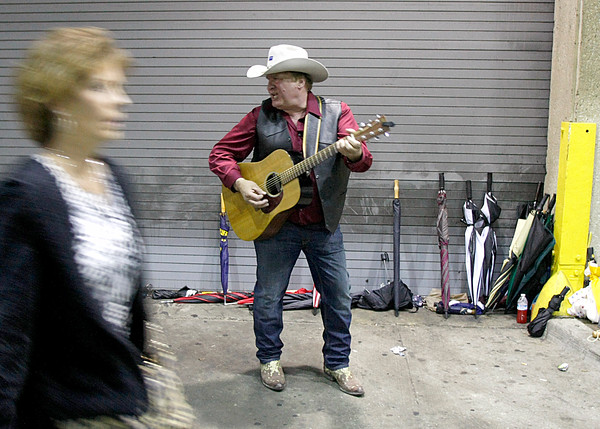 Kraig Moss, 57, Owego, NY, plays some Donald Trump-themed songs outside of the Louisville International Convention Center on Tuesday. Moss said he supports Trump because he thinks his policies will attack the heroin trade in the United States, a drug that killed his son. Staff photo by Jerod Clapp