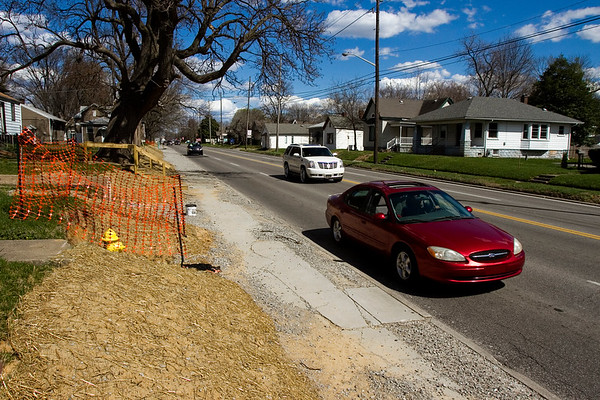 Traffic moves along East 10th Street past utility relocation work that was made in preparation for a widening project in Jeffersonville on Thursday afternoon. Staff photo by Christopher Fryer