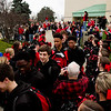 The New Albany Bulldogs load onto the team bus after leaving the Doghouse past cheering fans on the way to Indianapolis where they are scheduled to play McCutcheon in the Class 4A state championship at Bankers Life Fieldhouse on Saturday night. Staff photo by Christopher Fryer