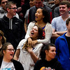 "New Albany seniors Ellie White, center left, and Bayasgalan Batsaikhan, center right, sing along to ""Sweet Caroline"" during a pep rally in the Doghouse on Tuesday ahead of the Bulldogs' Class 4A state championship game against McCutcheon that is scheduled for Saturday night at Bankers Life Fieldhouse in Indianapolis. Staff photo by Christopher Fryer"