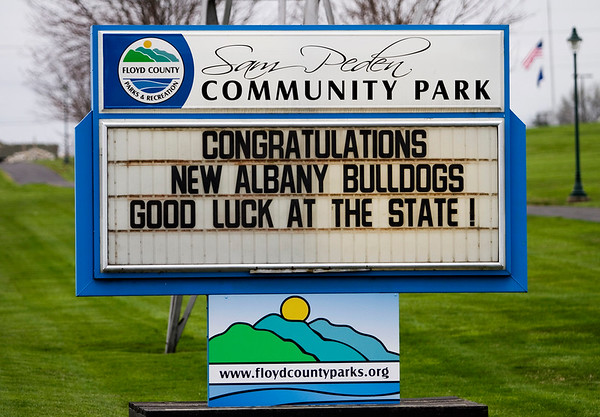 A congratulatory message for the New Albany Bulldogs is pictured on the marquee of the Sam Peden Community Park sign at the entrance to the park off of Grant Line Road on Friday morning. The team is scheduled to play McCutcheon for the Class 4A state title at Bankers Life Fieldhouse in Indianapolis on Saturday night. Staff photo by Christopher Fryer