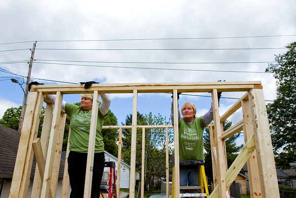 Tammy Hogan, left, and Lee Ann Pedolzky, both of Floyds Knobs, place a two-by-four on the frame work of a shed behind the home located at 2231 McLean Ave. in New Albany as part of Habitat for Humanity's National Women Build Week on Tuesday. Staff photo by Christopher Fryer