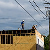 A crew with International Framing Contractors works on the exterior of the new building located at 121 E. Spring St. in downtown New Albany on Thursday afternoon. The structure is expected to be completed by this fall, and it will house the offices of T.J. Boofter Land Surveyor and Civil Engineer. Staff photo by Christopher Fryer
