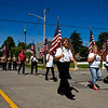 Members of the Veterans of Foreign Wars Post 3281 Auxillary participate in a procession along Market Street to the annual Memorial Day program at Veterans' Plaza in New Albany on Monday morning. Staff photo by Christopher Fryer